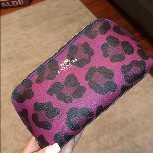 Coach ocelot leather cosmetic pouch